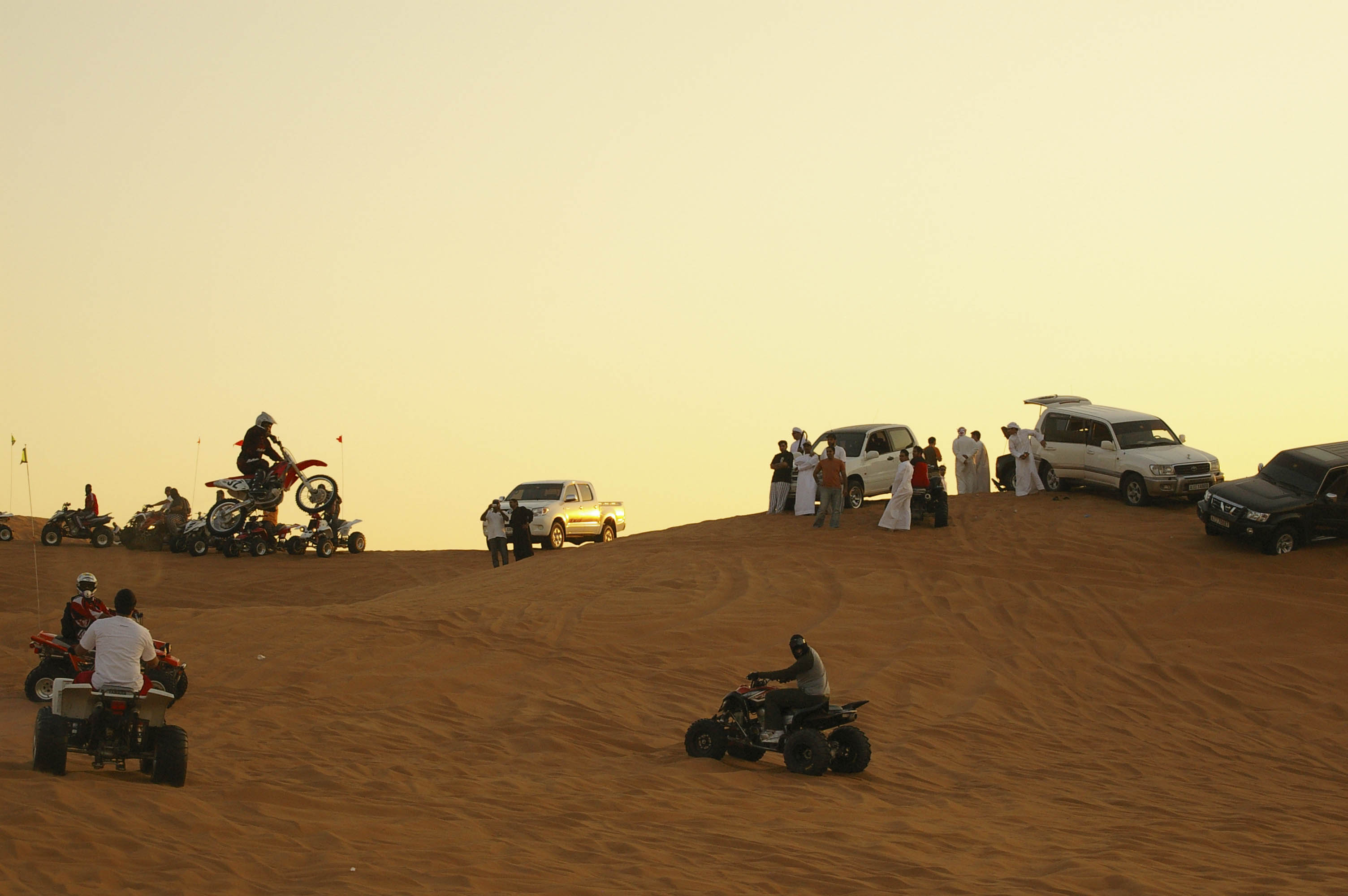 motorbikes and quad riding ride, sand dunes in desert of Dubai, UAE, November 2007
