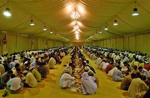Some of More than2,000 Muslims of different nationalities break their fast with Iftar, the Ramadan evening meal for free at the Sheik Zayed bin Sultan Al Nahyan, UAE president's Ramadan tent in Dubai, United Arab Emirates (AP Photo/Kamran Jebreili)