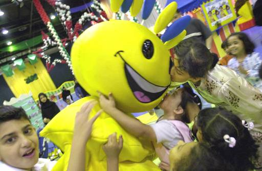 Arab children play with Modhesh, the cartoon character at the Modhesh during the Dubai Summer Surprise in Dubai